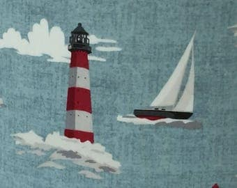 Yachts and lighthouses. Handmade fabric ceiling lampshade, yachts and red and white lighthouses with pale blue background