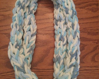 Light blue variegated with white finger knitted scarf