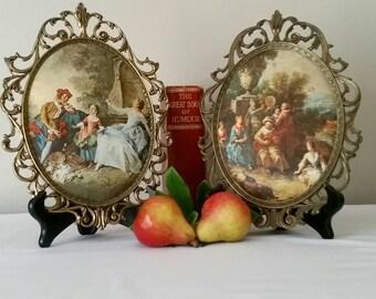 Very beautiful Vintage romantic scenes on padded silk in ornate brass metal frame.
