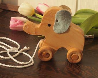 Wooden elephant on wheels