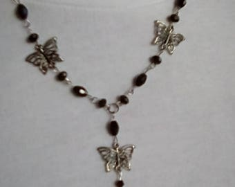 Black crystals and antiques silver butterflies pendant