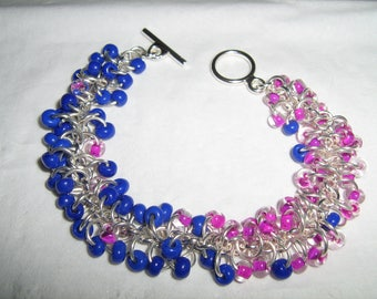 Shaggy Loops Pink-line and Blue opaque Bracelet