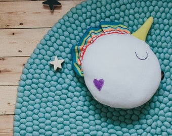 Unicorn softie / pillow with a little glow in the dark heart
