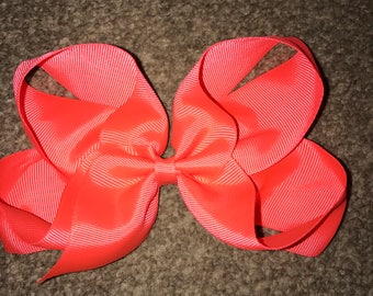 Neon orange 8 inch hair bow