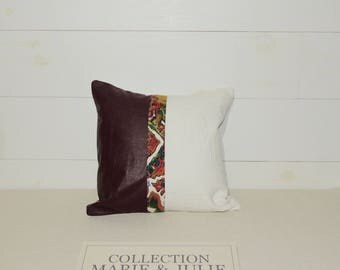 Decorative cushion in leather and linen