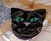 Black cat with green eyes glass ornament