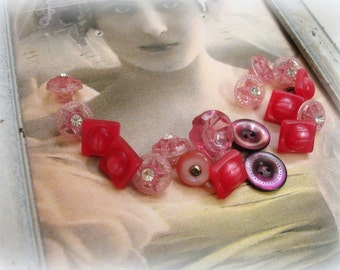 assorted vintage buttons in shades of pink plastics rhinestones and mother of pearl