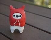 Hoodie Friend in red hoodie w/skull on the back