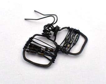 Black hammered and wired with beads earrings