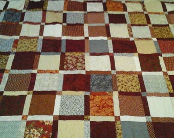 King size red, gray and tan quilt