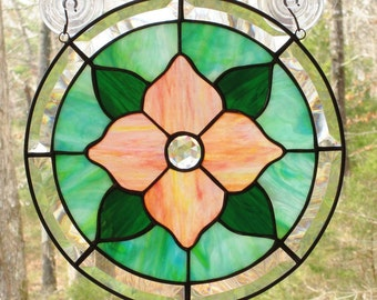 Round Stained Glass Panel, Peach - Pink Flower, Dark Green Leaves, Mixed Blue Green Background, Clear Jewel, & Beveled Border   12 1/4""