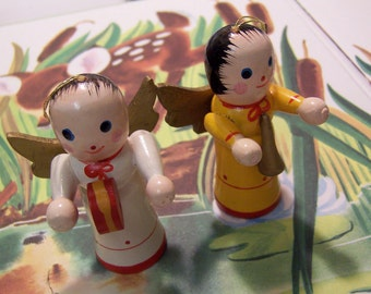 two adorable painted wooden angels