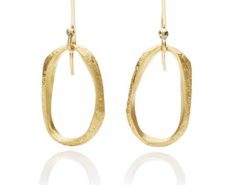 Medium cast hand carved texture hanging earrings