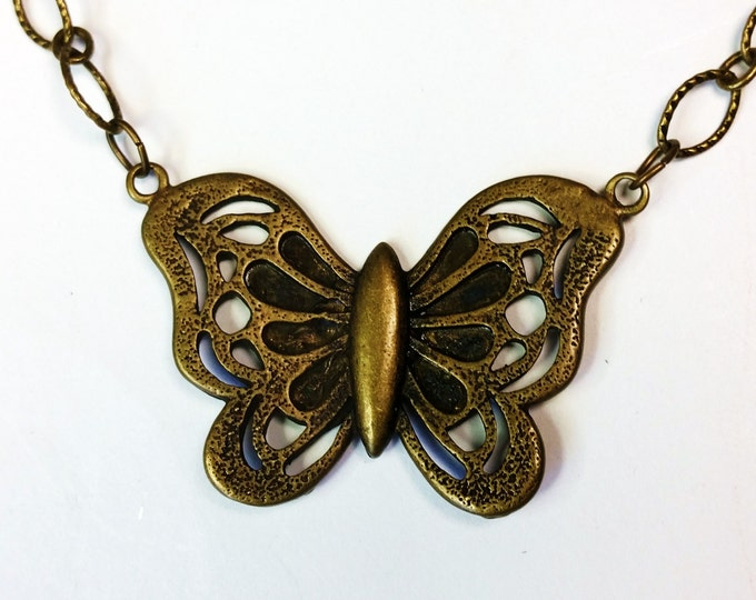 Perky Antique Brass Butterfly Pendant on Antique Brass Etched Oval Link Chain
