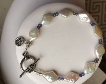 Bracelet — Freshwater Pearl Kites, Iolite and Sterling Lotus Blossom Charm