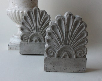 two cement architectural shell details