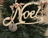 NOEL, vintage text ornament, with silver glitter, silver oaoer rosette, crinkled seam binding ribbon