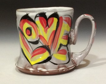 Love mug in red yellow and black on white