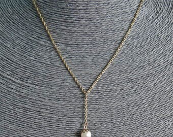 """1928 brand signed Vintage gold tone 16"""" necklace with attached 1.5"""" pearl center drape in great condition"""