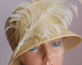 Stylish Cream Silk Hat with Feather Detail
