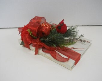 Christmas Flower Floral Arrangement on Book With Cardinal