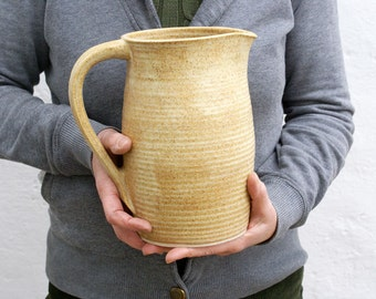 Tall bellied pouring jug - wheel thrown and glazed in natural brown