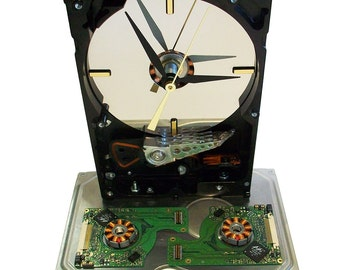 This Gadget is a Computer Hard Drive Clock Accented with Colorful Laptop Circuit Boards & Copper Motor.