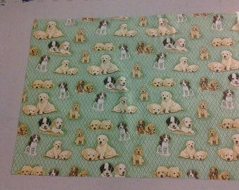 fabric with cute puppies on green 247751