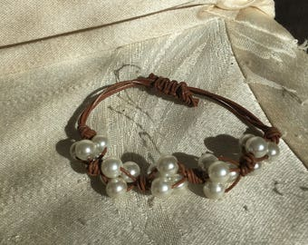 Woven pearl and leather bracelet