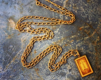 """Necklace / United States Postage Stamp Pendant / 100 Years of Petoleum Industry 1859-1959 / Assemblage and Jewelry / Solid Brass / 50"""" Chain"""