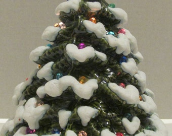 "Ceramic Christmas Tree with heavy snow and lights ~ This tree is 8"" tall x 6"" wide"