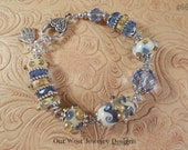 SRAJD Handmade Lampwork Bracelet - Ivory Base with Blue and Gold - Czech Crystal No 66