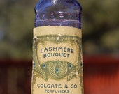 Antique original tiny Colgate Company Cashmere Bouquet Perfume bottle purple embossed and labeled orig brass and cork cap Photo Prop