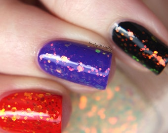 "Nail polish - ""All the Feelings"" Red to green shifting glitter in a clear base"