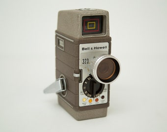 Vintage 1960s Bell & Howell 323 8mm Camera with Original Manual - Sun Dial