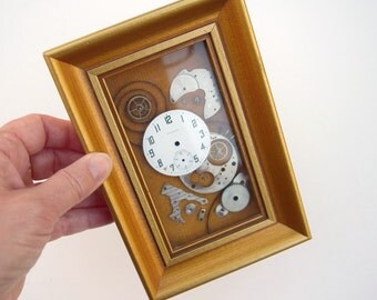 Shadow box wall hanging old watch parts steampunk style art work Girard Standard watch USA