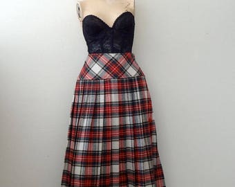 ON SALE 1980s Midi Skirt / pleated tartan plaid side button a-line with yoked waist / vintage preppy fashion