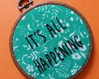 It's all happening - Almost Famous quote hand embroidered wall art on vintage green floral fabric