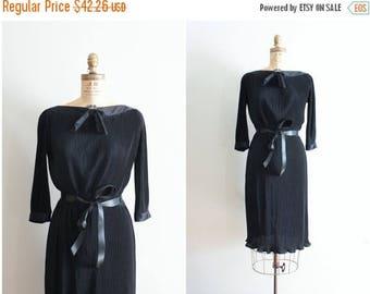 SPRING SALE vintage 1970s accordian pleat dress - 70s little black dress / satin bateau neck & bow dress / 70s pleated polyester dress