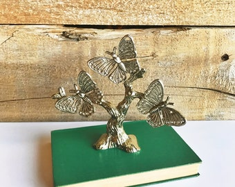 Metal butterfly earring holder. Butterflies on a tree.