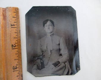 antique tintype - woman sitting in chair