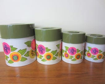 Vintage set of 4 metal flower power canisters with avocado green lids.