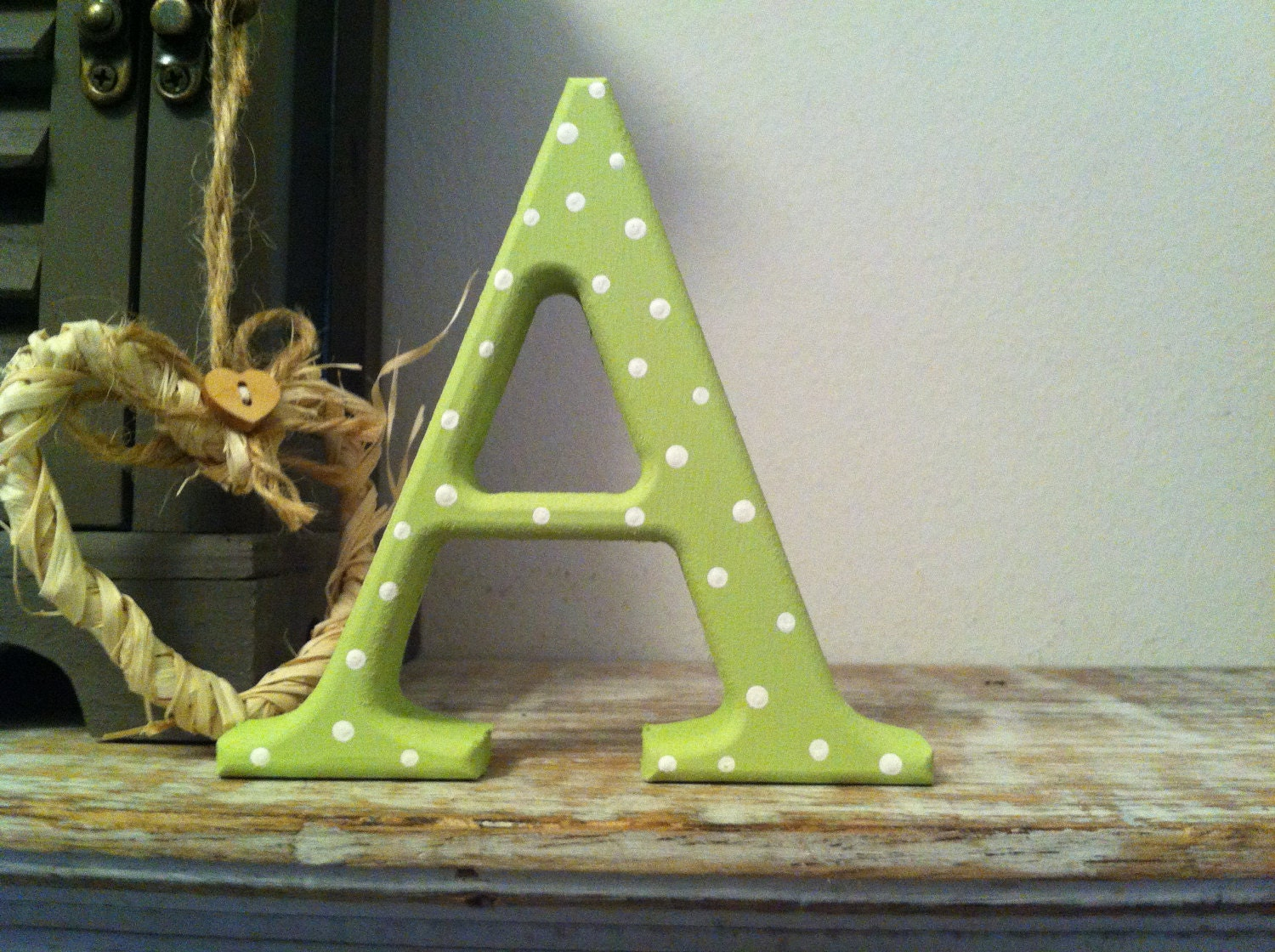 Letter A in Georgia Font, with a lime green and white polka dot finish