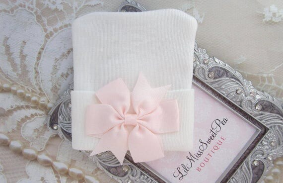 White Newborn Hospital Hat with a light pink pinwheel ribbon pearl bow, baby hat, ready to ship, shower gift, Lil Miss Sweet Pea Boutique