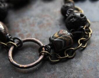 Rustic amulet bracelet, double chain bracelet, antique gold, black and garnet bracelet, spiral symbol bracelet, aged looking bracelet