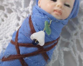 Swaddled podling child,  elf baby, fairy baby, make believe  Metamorphosis