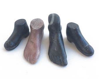 carved stone folk art, hand carved small shoes and feet, prisoner art, small figural carvings