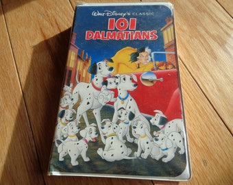 Vintage Disney VHS Black Diamond Edition of 101 Dalmatians in the original plastic container in Vintage Condition but the VHS Tape is fine