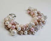 Ivory, pink, and rose cluster necklace, bracelet and earrings.