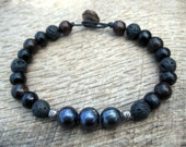 Mens surfer bracelet, genuine black pearl, freshwater pearl, black lava stone, wood and metal beads, toggle and loop clasp, one of a kind